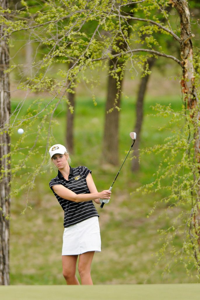 Missouri junior Marissa Cook chips the ball onto the 15th green on April 23, day two of the Big 12 Women's Golf Championship at The Club at Old Hawthorne. Leading the MU golf team, Cook shot two under par for the day.