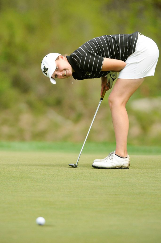 Missouri junior Hannah Lovelock watches her ball teeter on the lip of the 15th hole before it dropped in for a birdie on April 23 at The Club at Old Hawthorne. The Women's Big 12 Championship was held in Columbia, MO and the Missouri Tigers placed third overall.