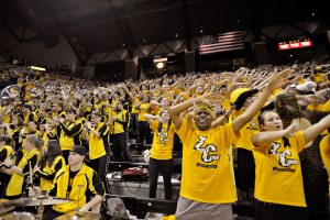 The Zou Crew, the Missouri student fan section, cheer on the Tigers in the final minutes of the game against the University of Colorado on Feb. 5th at Mizzou Areana. Missouri went into this game ranked #14 and won 89-73.