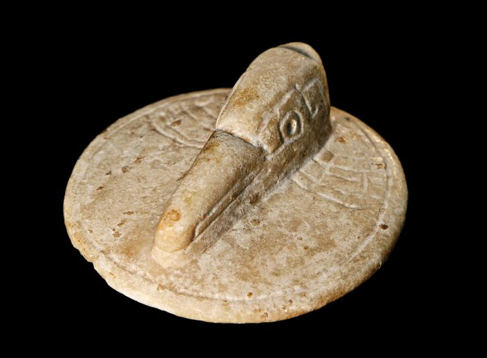 Mayan Bird Lid; Carved alabaster; Mexico; Classic Period (A.D. 400-600). University of Missouri MAC1986-0054.