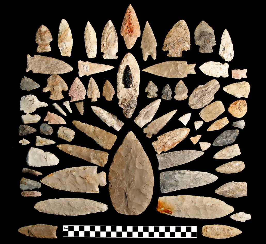 Flakestone Projectile Points & Scrappers; Flint & chert rock; Multiple locations; Prehistoric. Flakestone tools are produced by striking a flint or glass-type rock and refining the pieces, or flakes; flakestone tools changed significantly over time and aid in identifying cultures. University of Missouri Lubensky Collection MAC1995-0138a.