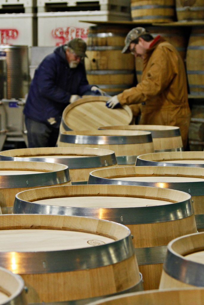 Two employees complete a final sanding by hand of oak wine barrels produced on Dec. 9th at A & K Cooperage in Higbee, MO. The cooperage has been owned and operated by the Kerby family for three generations and produces around 5000 barrels a year.