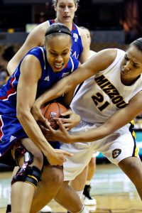 Missouri Sydney Crafton fights for possession with University of Kansas Tania Jackson on Jan. 26th at Mizzou Arena. Missouri coach Robin Pingeton said she appreciated her team's effort to go after loose balls as Mizzou won 66 to 52.