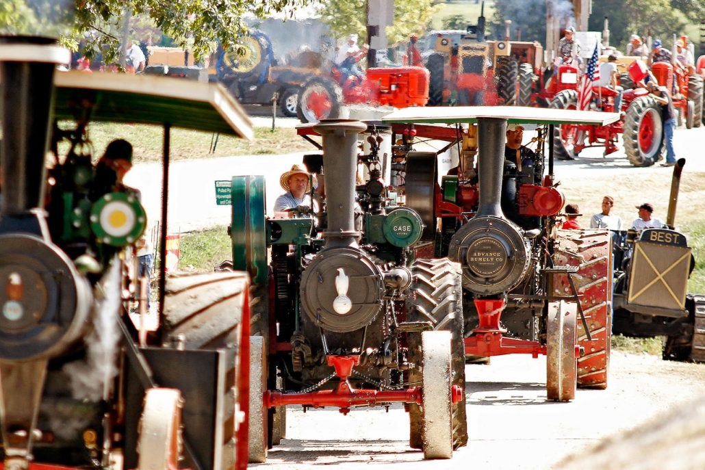 Bob Gallo, center, operates a 1913 Case steam traction engine, featuring a 50 horsepower engine with an operating weight of near 20,000 pounds, on Sept. 11th during the Parade of Power. The Missouri River Valley Steam Engine Association puts on the annual Back to the Farm show which celebrates early American agriculture.