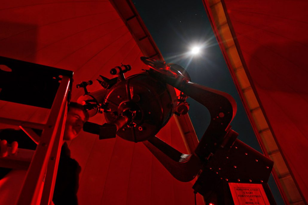 A Mizzou student gazes at the moon through the telescope at Laws Observatory on the top of the Physics Building of the University of Missouri on November 9. The Central Missouri Astronomers Association has partnered with the Astronomy Department and opens the observatory to the public every Wednesday evening throughout the year, weather permitting.