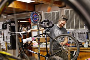 Mark Bendel works on an Trek mountain bike in for a tune-up at Walt's Bicycle Fitness and Wilderness Company on April 21st. Bendel is the service manager at Walt's and has worked on bikes almost continuously since 1981.