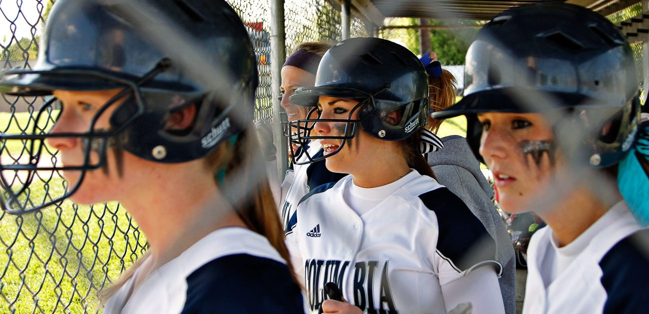 Columbia College shortstop Kristin Eiken, left, pitcher Valerie Teter, center, and first baseman Rachel Coleman, right, cheer on a teammate's at-bat on May 3rd during the first semifinal game of the American Conference Tournament at Cougar Softball Field. The William Woods University Owls beat the Columbia College Cougars 0-1 and 8-9.