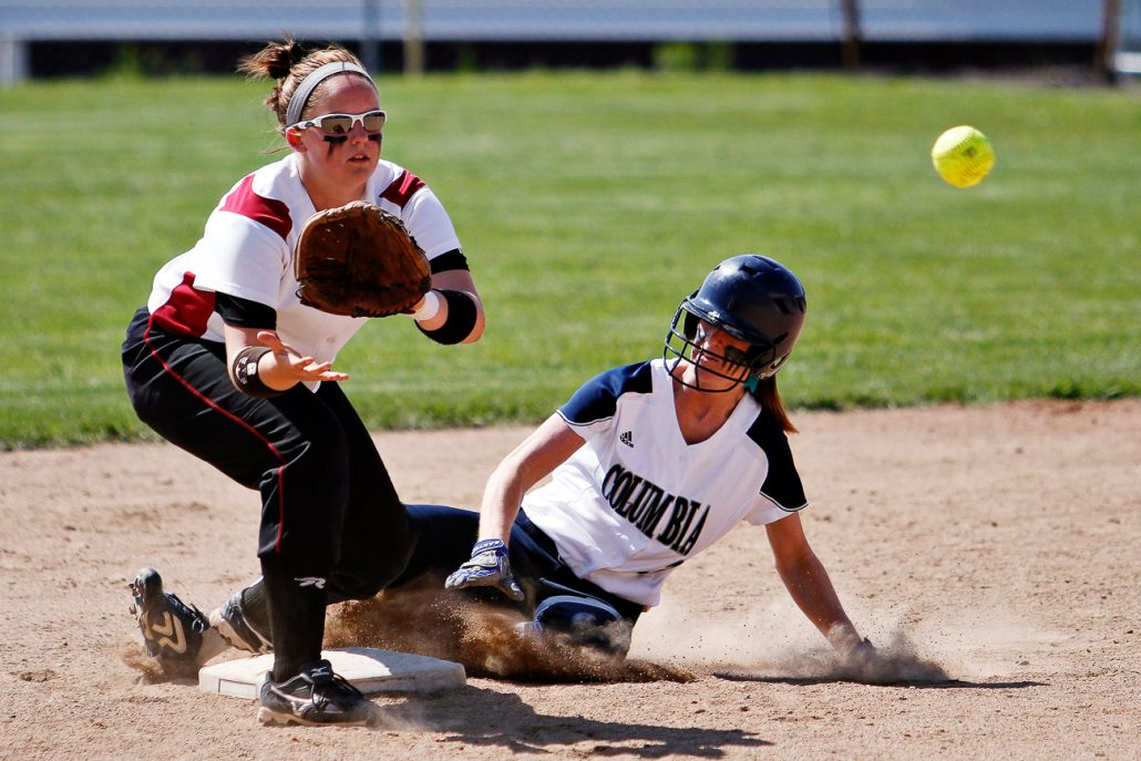 Columbia College freshman Kristin Eiken slides safely into second base as William Woods Owls infielder Taylor Lewis tries to tag her out on May 3rd during the first semifinals game of the American Conference Tournament at Cougar Softball Field. The game remained scoreless until the Owls brought a run home in the top of the ninth inning.