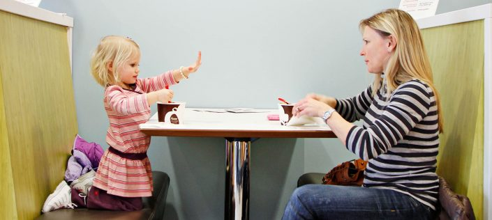 "Carly Meyer, 3, shows off clean hands while enjoying a cup of frozen yogurt with her mother, Chrissy, on Tuesday afternoon, January 18, 2011, at the new Red Mango in downtown Columbia. Commenting on the yogurt shop, Chrissy Meyer said, ""I'm so glad they have one here now."""