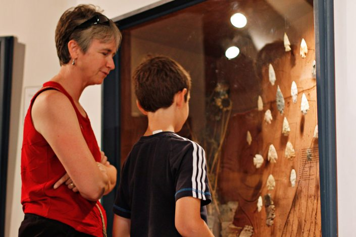 Visitors inspect archaic points during the annual Museum Crawl at the University of Missouri's Museum of Anthropology.