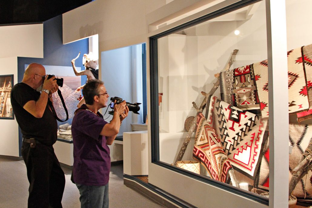 Visitors take pictures of Southwestern Native American rugs during the annual Museum Crawl at the University of Missouri's Museum of Anthropology.